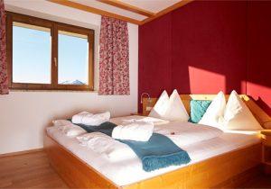 bedroom - apartment tschaneck - hotel hutter